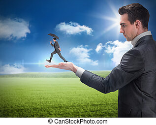 Composite image of businessman holding business man jumping...