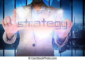 Businesswoman presenting the word strategy against room with...