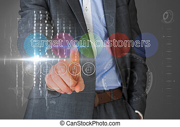 Businessman touching the words target your customers on...