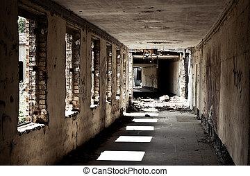 empty hallway of a former hospital