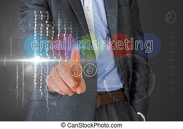 Businessman touching the words email marketing on interface...