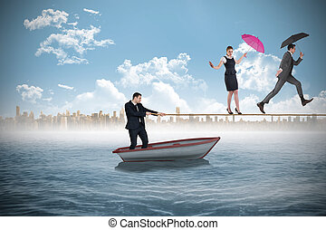 Young businessman pulling a tightrope for business people...