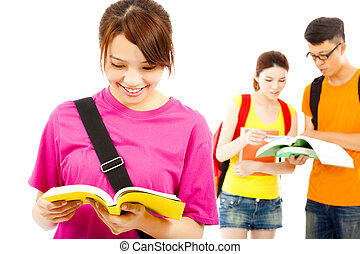 asian young student read a  book  with classmates