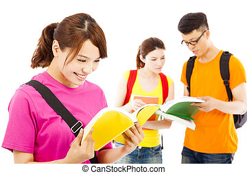 young student read a  book  with classmates