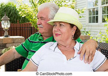 Elderly couple sitting gazing into the distance - Elderly...