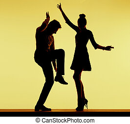 Young fit couple dancing at the party