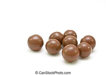 Round bonbons isolated on white.