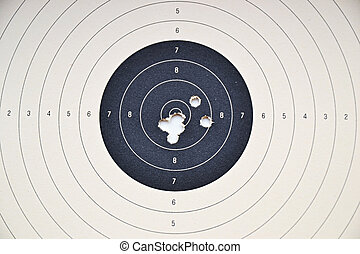 Target and holes - Detail on holes in paper target without...