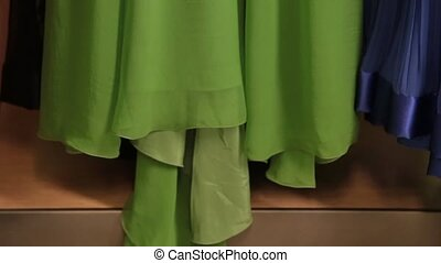 green dress - beautiful green dress on a hanger in the room