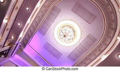 ceiling in the hall - large chandelier hanging in the hall...