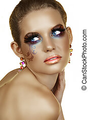 blond with artistic make-up - tanned blond woman with...