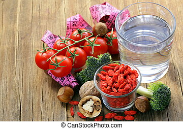 dried goji berries, water, nuts and fresh vegetables for a...