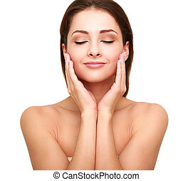 Beautiful spa woman with clean beauty skin touching her face...