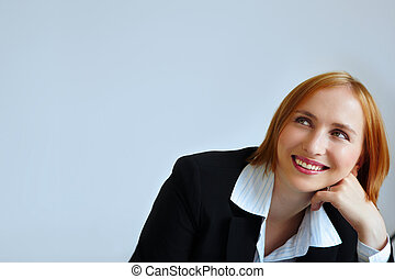 reddhead businesswoman in jacket