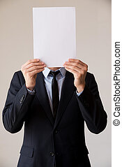 Paperwork in his head. Man in formalwear hiding his face...