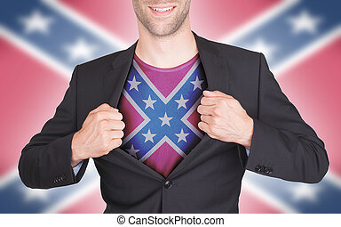 Businessman opening suit to reveal shirt with flag,...