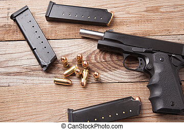 Gun with Bullets - A 1911 45 caliber pistol with bullets.