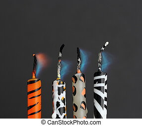 Animal print candles after being blown out