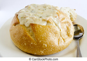 Clam Chowder Bowl - A bread bowl filled with clam chowder.