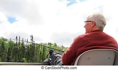 Retired Senior Male lake fishing 1 - Retired old male...