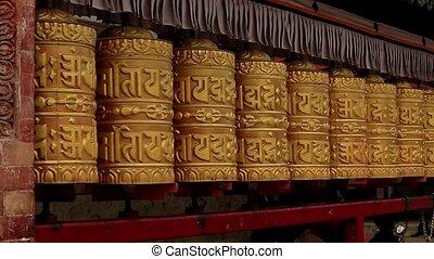 Buddhist prayer wheels. Swayambhunath Stupa, Kathmandu,...