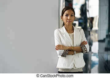 Portrait of young happy hispanic business woman