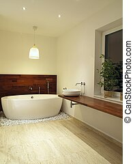 Freestanding bath - Modern en suite bathroom with travertine...