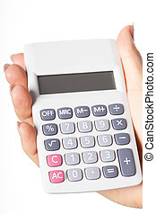 Holding calculator - Hand holding simple calculator on...