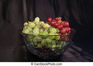 Grapes in Crystal Bowl - Red and Green grapes in a crystal...