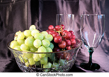 Grapes and Wine Glasses - Red and green grapes in a crystal...