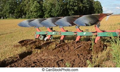 tractor slowly ploughing farm field soil Slow motion