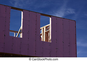 New Housing Insulation - A new housing project with pink...