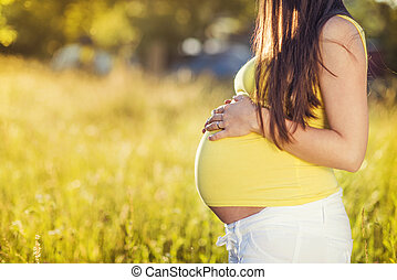 Pregnant woman - Outdoor portrait of unrecognizable pregnant...