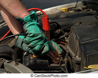 Battery charging - Charging battery in car by mechanic in...