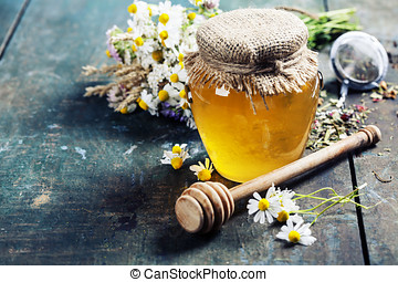 Honey and Herbal tea on wooden background - summer, health...