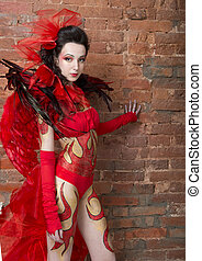 Body art - Carnival costume-fire with the elements of body...