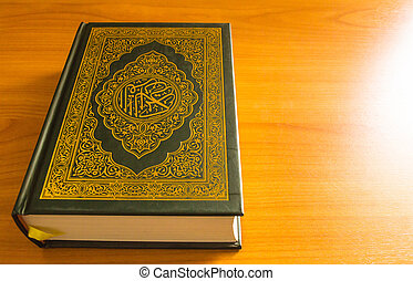 quran on the wooden table background