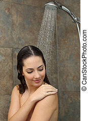 Beautiful woman cleaning skin in the shower - Beautiful...