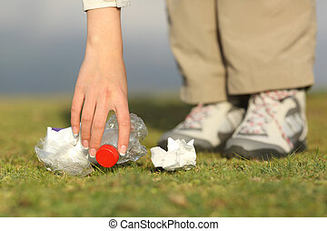 Eco hiker hand collecting garbage in the mountain - Eco...