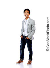 Full length portrait of happy fashion asian man isolated on...