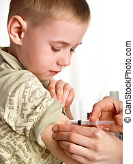 the injection - A doctor giving a child an injection