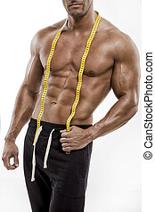 Muscle man with measuring tape - Muscle man posing with...