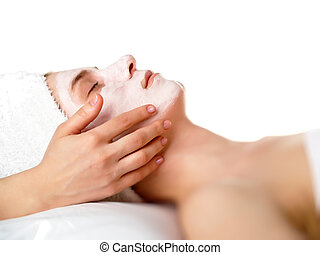 spa treatment - face of women getting a spa treatment
