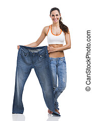 Diet concept - Woman with large jeans in dieting concept