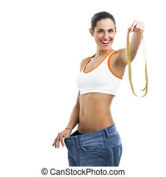 Diet concept - Woman with large jeans in dieting concept...