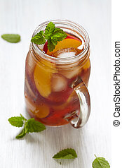 Peach ice tea - Fresh peach ice tea in a mason jar