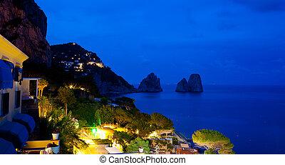 View of Marina Piccola and Faraglioni by night, Capri island...