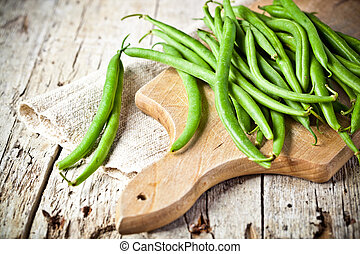 green string beans closeup on wooden board