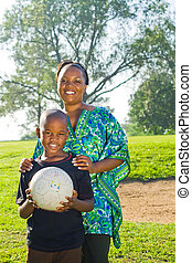 mother and son - mother with sporty son with football