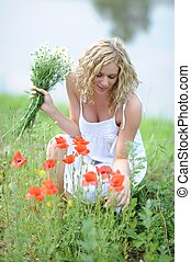 Blonde woman picking flowers - Young blonde woman picking...